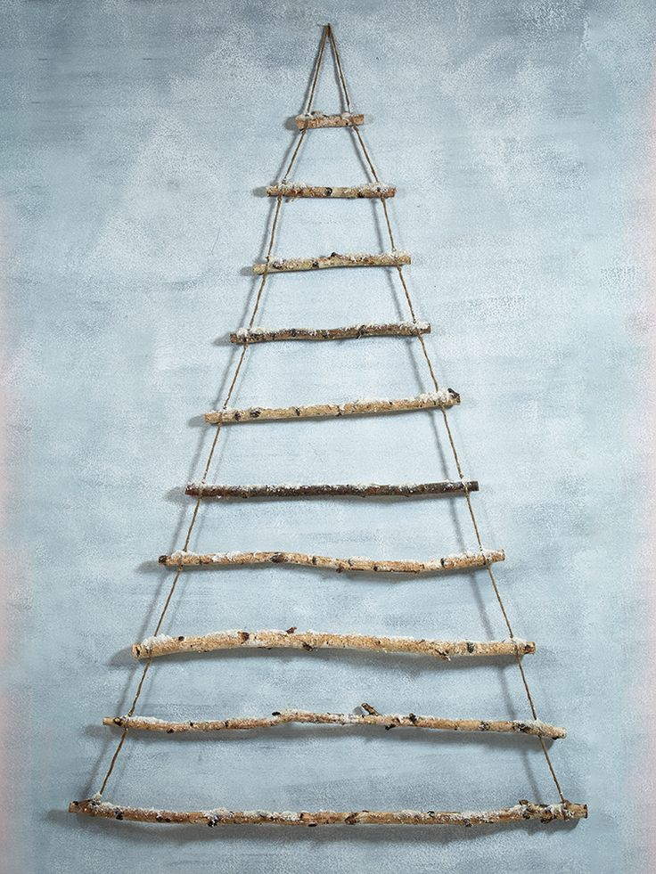 Perfect for those who love Christmas but are short on space, our rustic hanging tree has been carefully created using ten natural birch branches hung together with strong jute string. A naturally inspired contemporary tree that works as an addition or alternative to your traditional fir tree, each branch has a dusting of gently sparkling snow. Easy to hang from a hook on your wall, this tree can be displayed alone in your entrance hall or used as the main attraction teamed with an array of…