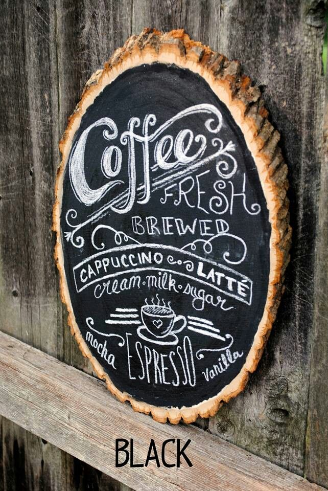Mixed typography chalkboard sign on natural raw wood slice with bark