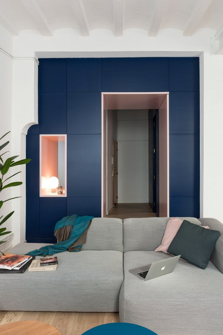 To offer some separation between the home's entranceway and the main living area, the architects created a full-height storage unit where the client can keep her clothes and other belongings.