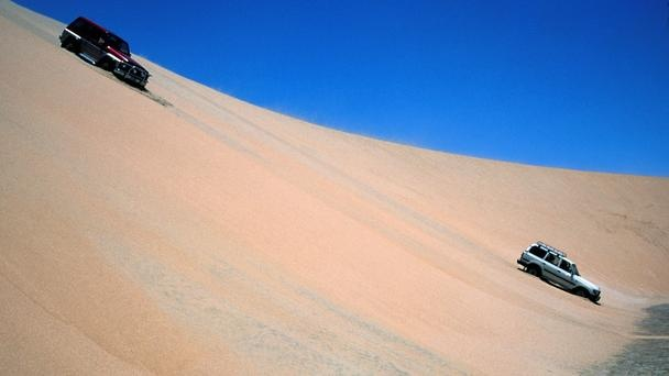 A desert road trip  Drivers take to the dunes in a sandy adventure. (Christine Osborne/LPI)