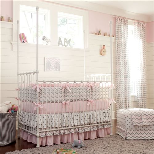 Pink and Gray Chevron Crib Bedding by Carousel Designs. Baby girl nursery idea in pink and gray circles, stripes, and chevrons. #carouseldesigns
