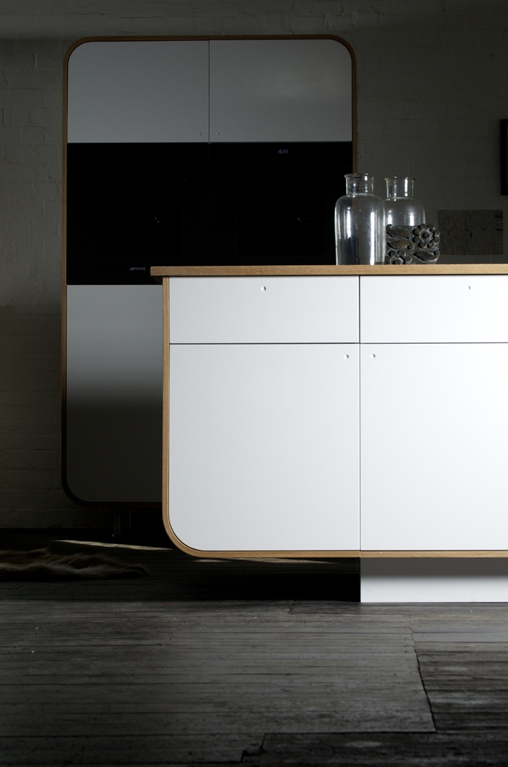 Air Kitchen: designed by DeVOL using HI-MACS® - simple doors with no handles, clean and brilliant!