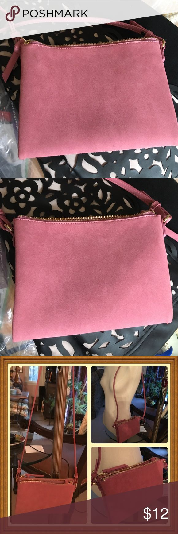 Old Navy Cross body pink suede (like) bag Double zipper compartments. New without tag.  If have kids I have NEW in box Disney figures and many other things not for kids ($11 or less) as free with purchase 💕❣ All my clothes smoke-animal hair-free. Old Navy Bags Crossbody Bags