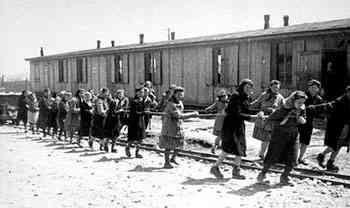 "Jewish women at forced labor pulling hopper cars of quarried stones  along ""Industry Street"" in the Plaszow concentration camp, 1944"