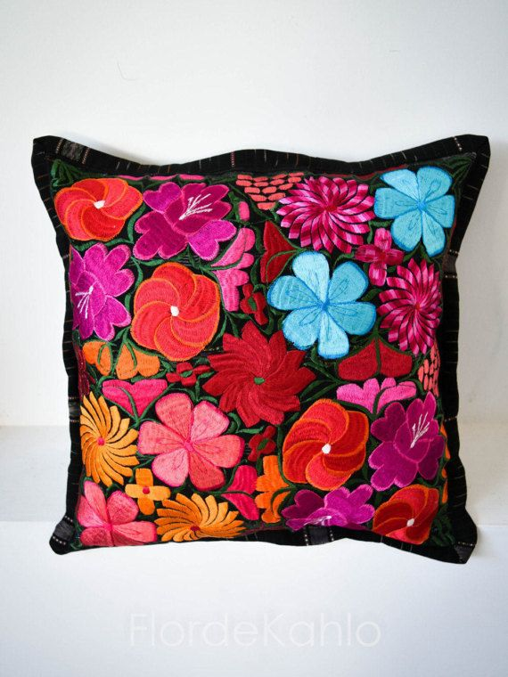 This traditional pillow cover is whimsical, precious, and comfortable. It has been embroidered in sedalina by a group of female artisans from Chiapas, Mexico.  The embroidery on this pillowcase is spectacular with a colorful typical Mayan design. Each cushion cover is unique and entails a detailed set of flowers. The back of the cushion is plain, it features a zipper closure in the back. Any question, please feel free to ask!   FABRIC - Natural Cotton canvas with cotton and sedalina…