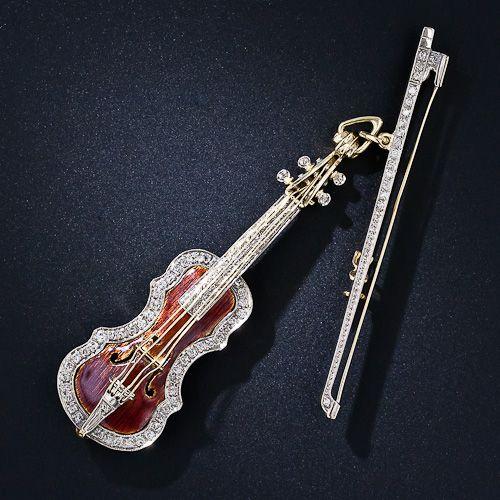 """Enamel and Diamond Violin and Bow Brooch. Very nice. Music for your eyes! A piccolo Stradivarius violin c.1760 is realistically    two-tone 18 karat yellow and white  4566   gold and is signed """"Stradivari A.D. 1760' on the back corner. The violin measures    2 3/4 inches long and the bow measures 2 1/2 inches. N.B. The brooch is circa mid-twentieth century (not 1760).  Inventory No. 50-1-4566"""