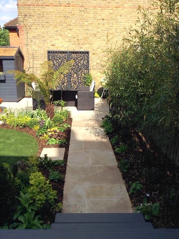 See this small London garden transformed into a stylish low maintenance space with circular artificial lawn and entertaining/dining area