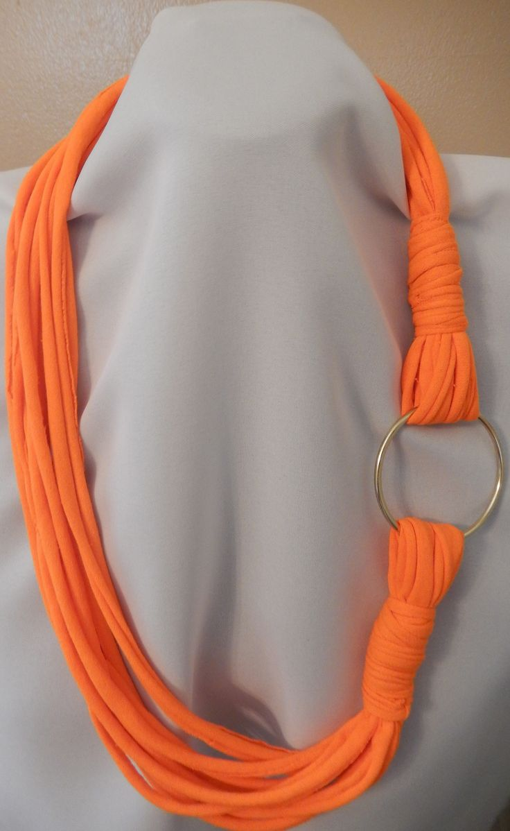 Orange rope style scarf with ring.