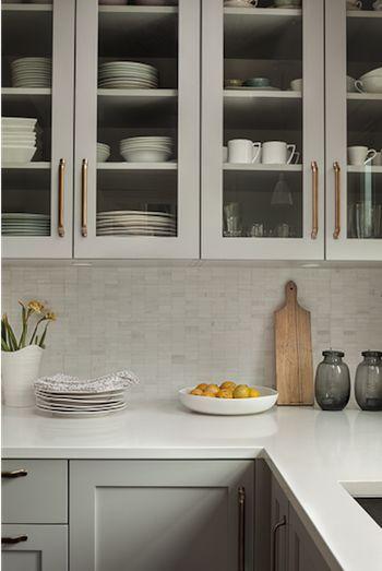 gray cabinets, brass pulls, marble backsplash