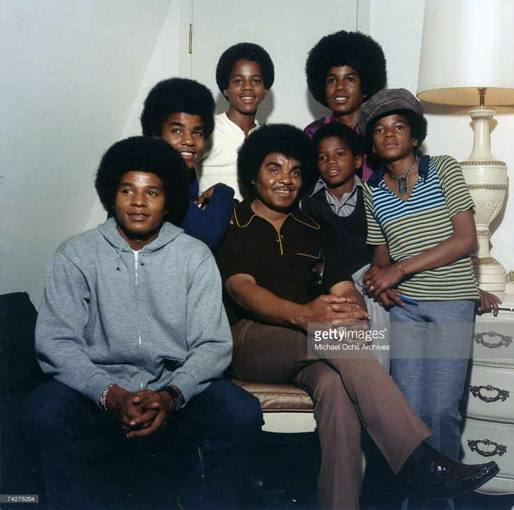 R&B quintet 'Jackson 5' pose for a portrait with their youngest brother Randy and father Joe. Clockwise from bottom left: Jackie Jackson, Tito Jackson, Marlon Jackson, Jermaine Jackson, Michael Jackson, Randy Jackson, Joe Jackson (front).