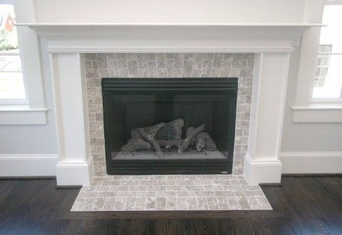 3x6 walnut travertine laid like brick around gas insert fireplace.  1710 N. Adams St. Arlington, VA 22201 « Arlington Property Ventures, LLC