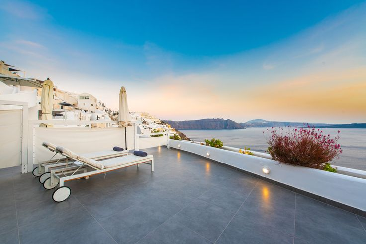 Share the famed Santorini sunset with your significant other at the Santorini Secret Suites & Spa