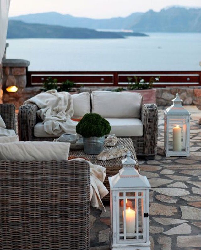 Beautiful Back Patio Overlooking The Sea With Lanterns, Candles And Chunky  Rattan Furniture. Mirage