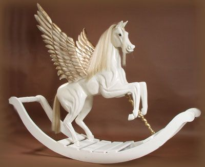 Handmade pegasus rocking horse available in the UK. Makes me want to be a kid again :)