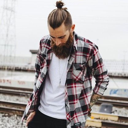 Trevor Jon Wayne (@trevorwayne), pulling out the killer top knot - epic beard combo.  by @gilsphotography  #beards #beardlife #topknot: