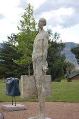 """Don't forget to stop in at Red Rooster to visit the infamous trouble maker Frank """"The Baggage Handler"""", who was first commissioned by the City of Penticton as a temporary art installation in the city's roundabout. What started as a simple public art project soon became a media frenzy of international proportions, spurring a 3 year debate.  Frank is both loved and hated by Penticton residents, but I think he brings some morose personality to wherever he lives."""