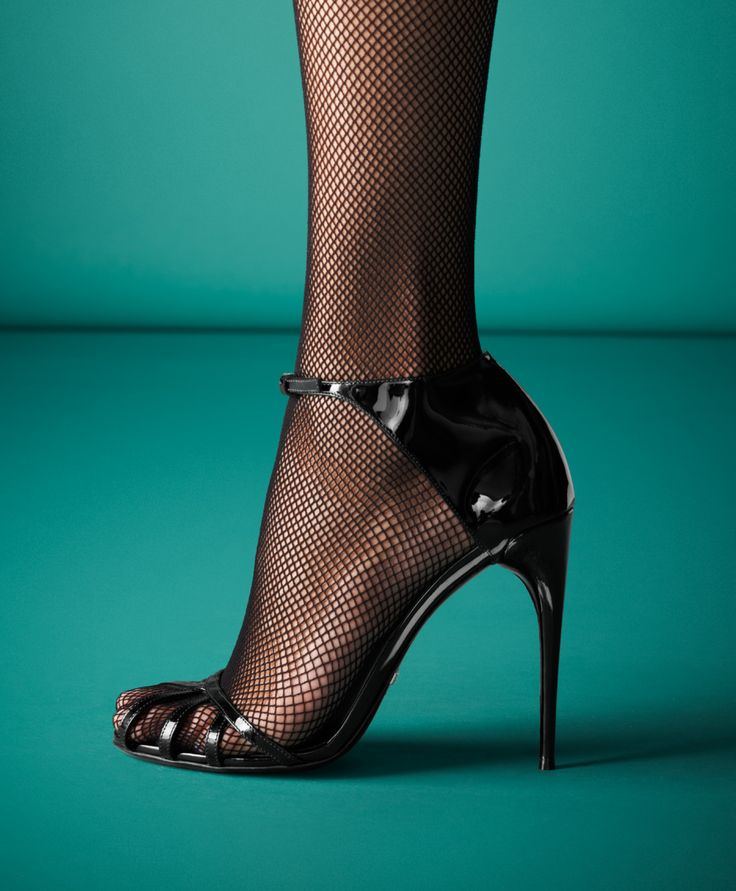 Gucci Margot Patent Leather Cage Sandal | Who would've thought that stocking and open-toed shoes could be hot?