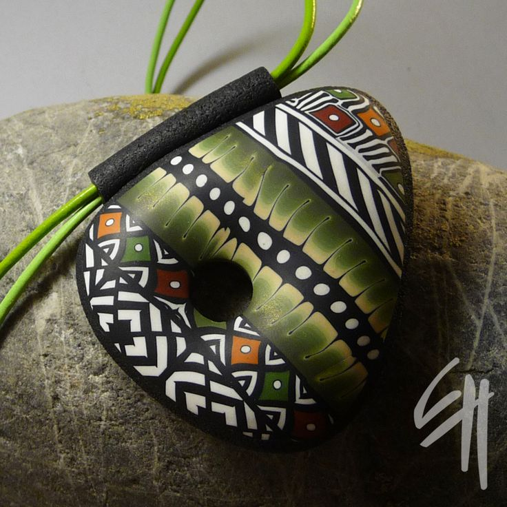 pendant Amerindian Triangle By Eva Haškova -- love the combination of B and warm colors