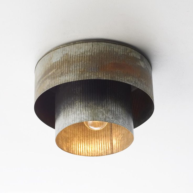 Corrugated Tin Drum Ceiling Light From a vintage industrial light for the mudroom, to a casual youthful look for your son's room, or even a natural ingredient in the kitchen, this layered double drum shade ceiling light adds a unique and chic element in corrugated tin with aged zinc finish.