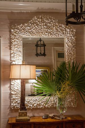 """These oyster shells all come from my clients property, making it extra special.  It's a big one, 70""""x42"""" with antiqued mirror glass."""
