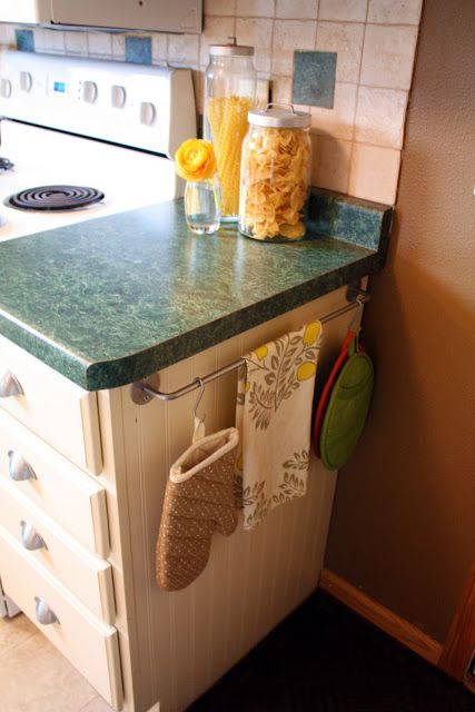 Add a towel rod to the end of a cabinet to hang potholders and dish towels.
