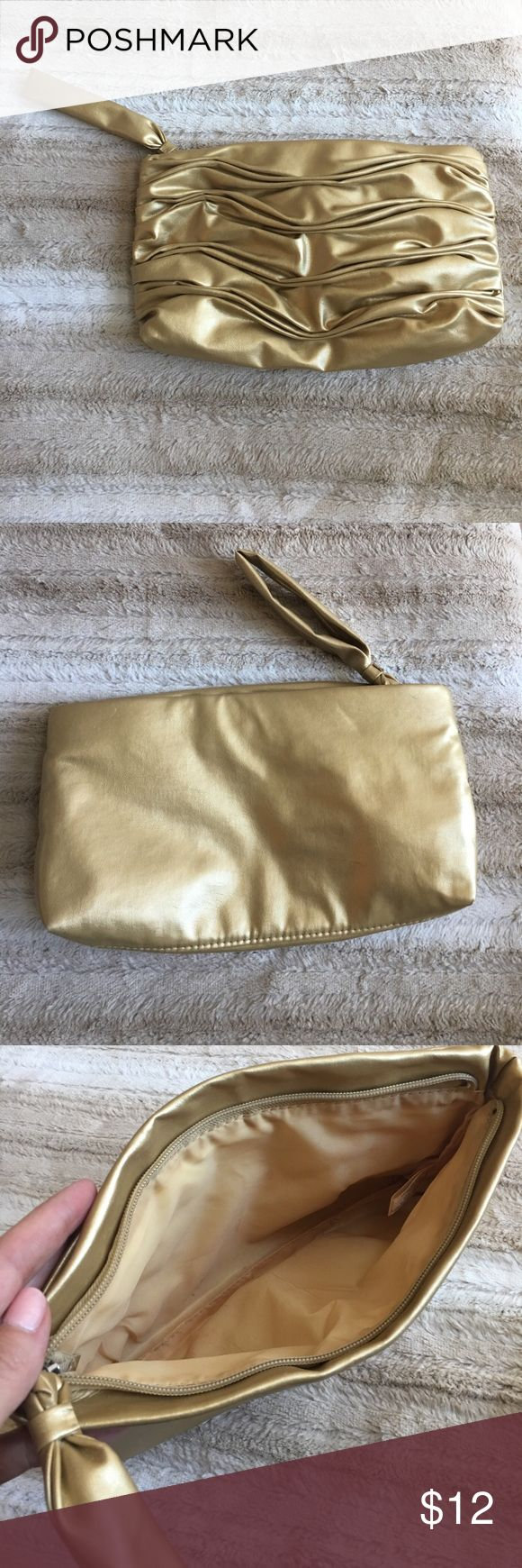 Go with everything gold clutch Dress up or down! The gold clutch is an outfit maker! Roomy inside! No inside pockets. A few small pen marks on liner inside. Exterior has no scratches on front. Small mark on back (see photo) Bags Clutches & Wristlets