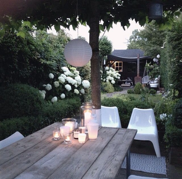 I dont like plastic chairs but I do love the atmosphere in this garden