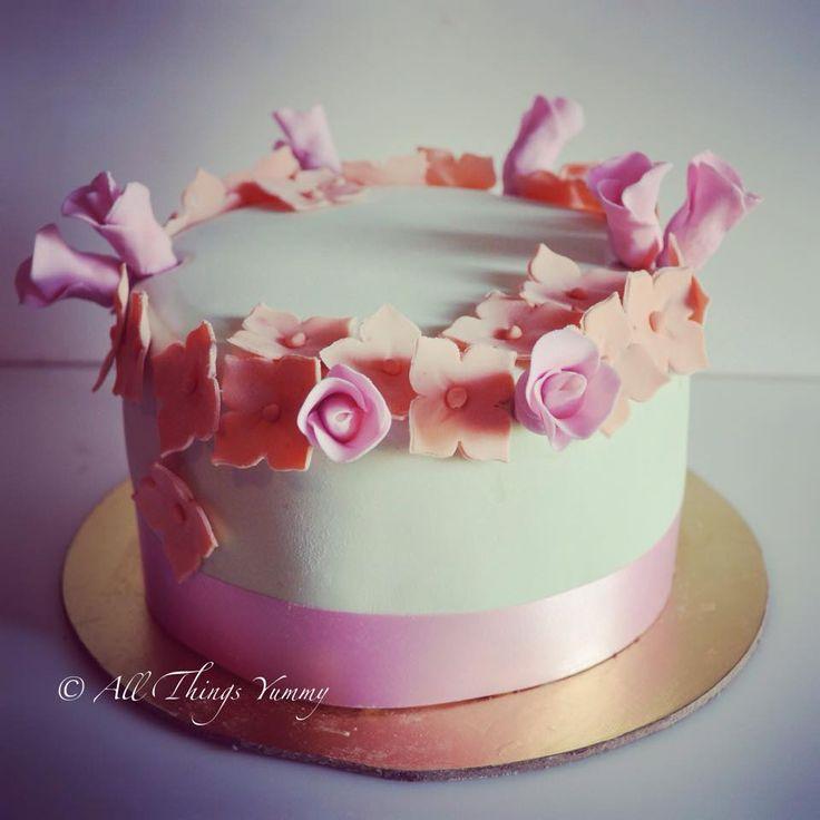 Floral Cake Decor - Mint Green Fondant Cake with Orange and Pink Sugar Flowers Decor | All Things Yummy #cake #sugarflowers #hydrangea #roses #birthdaycake #pretty #weddingcake #wedmegood #elegant #customisedcake #designercake #atyummy #cake #cakelove #vintage #pastel #peach #pink #mint #chocolatecake #party