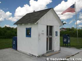 Smallest Post Office in the United States, Ochopee, Florida. It was formerly an old irrigation pipe shed for a tomato farm and has been used since 1953 since a fire destroyed the general store. it suits the town, with a population of 11, quite well