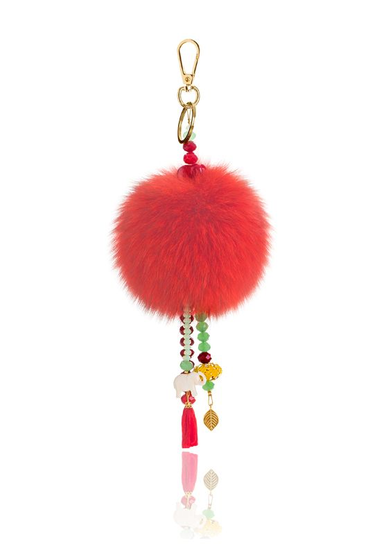 Pompon Bag Charm with 12cm red real fox fur, metal ring and clip, crystal beads and decorative elements.  Price: 42.00E