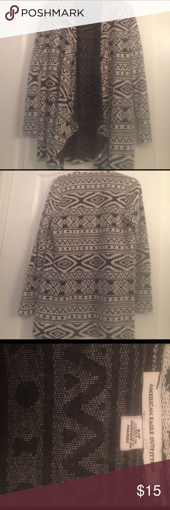 """American Eagle Aztec print cardigan Excellent used condition - only worn a couple times. Super soft. It has a really cool knit pattern - I tried to show in pictures. No buttons. It is a longer cardigan that is super cute with leggings or jeans. I am 5'1"""" and it completely covers my butt. American Eagle Outfitters Sweaters Cardigans"""