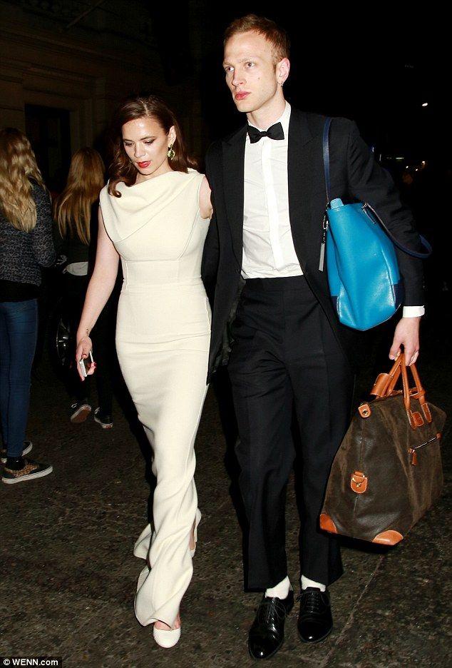 That's a fair few bags: Hayley left the Royal Opera House with her boyfriend Evan Jones...