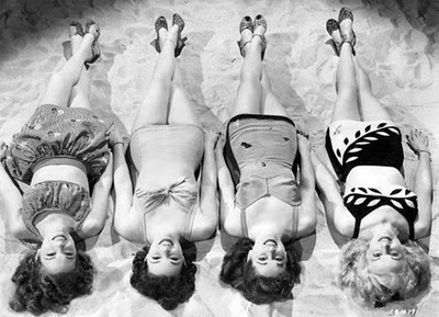 Old fashioned swimsuits and sunbathing