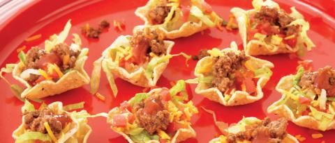 Chef Devin Alexander's Tiny Tacos   10 Tostitos Baked! Scoops  1/4 cup finely shredded romaine lettuce  2 tablespoons finely chopped tomatoes  1/2 ounce (about 2-1/2 tablespoons) finely shredded Cabot's 75% light cheddar cheese, or your favorite low-fat cheddar  1 teaspoon lower-sodium taco seasoning  2 ounces 96% lean ground beef  1 tablespoon mild or hot red taco sauce
