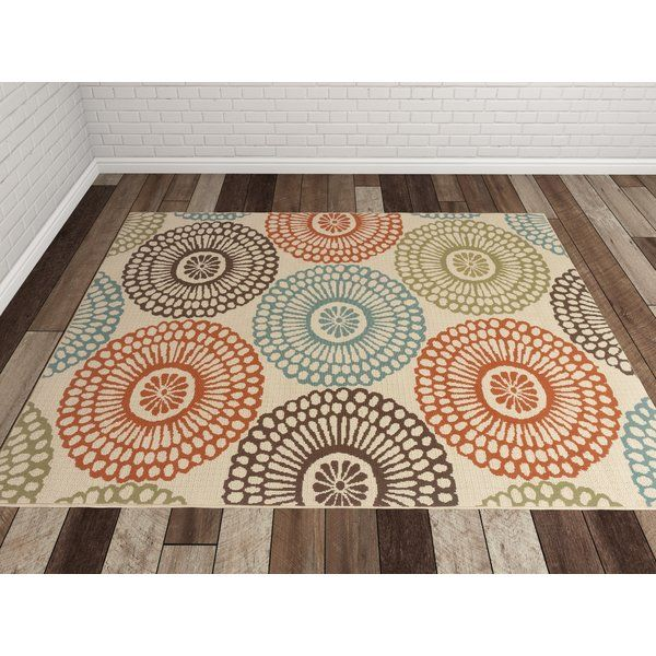Detailed with a chic multi-colored medallion motif and featuring a weather-resistant design, this lovely rug is perfect livening up a cozy poolside seating group or adding a pop of pattern to the sunroom.