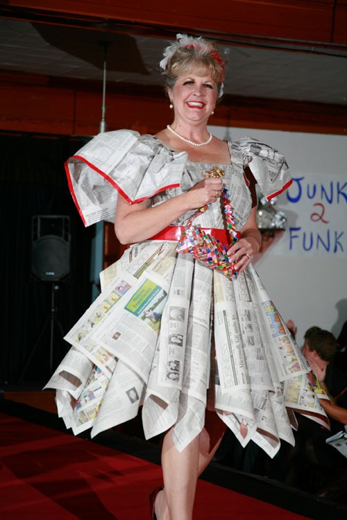 """Whats Black & White and Red All Over?  I LOVE LUCY!!"" by Ali Shute. Made of newspaper & miscellaneous recyclables. Featured in the 2012 Junk2Funk Eco-Fashion show, a benefit of the Kootenai Environmental Alliance that showcases the runway outfits made from recycled materials by local artists."
