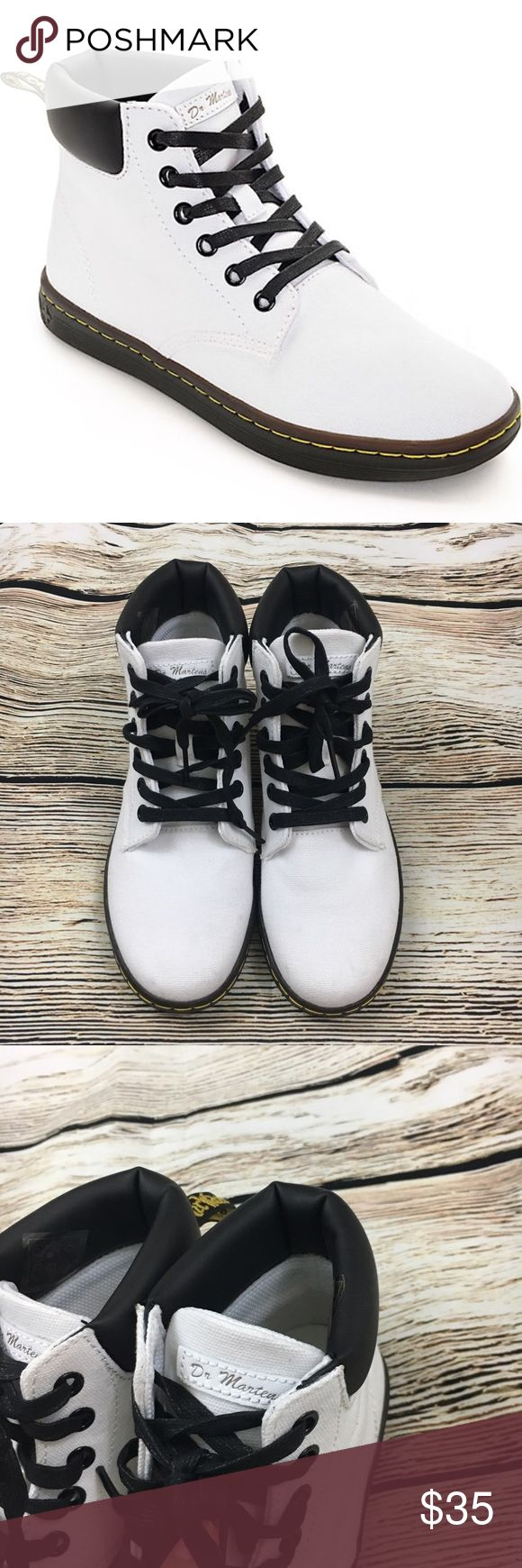 Dr martens Maelly white lace up tennis shoe 5 White canvas tennis shoes with black laces, new without box, minor marks around shoes from lack of being stored in box. Priced accordingly! Dr. Martens Shoes Sneakers