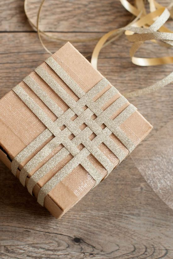 Gift Wrapping Inspiration * Weaving Ribbon for and interesting topper detail.