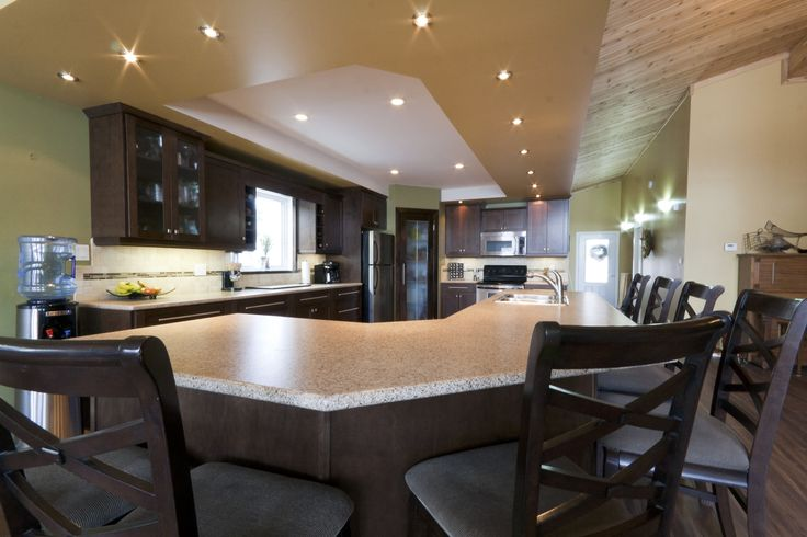 kitchen, dark cabinets pantry, large island. Bulk heads don't have to be unsightly. Make them a feature! www.thisnthatmfg.ca
