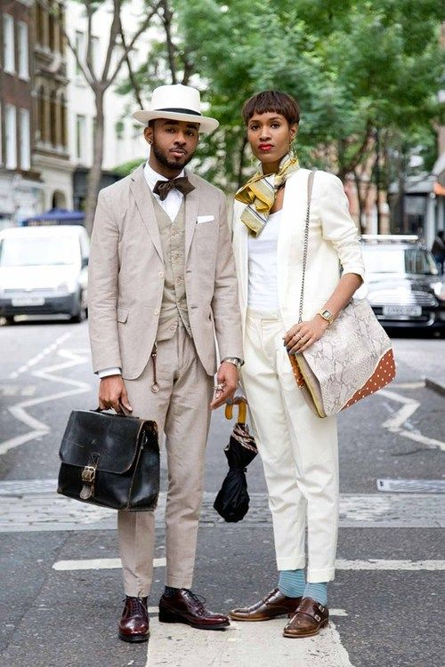 Donya Campbell and Martell Campbell. Martell wears Baileys hat, J.Lindeberg suit, French Connection waistcoat, Mr Porter pocket square, Pocket Square Clothing bowtie, Oliver Sweeney socks and shoes and vintage briefcase. Source: GQ.uk