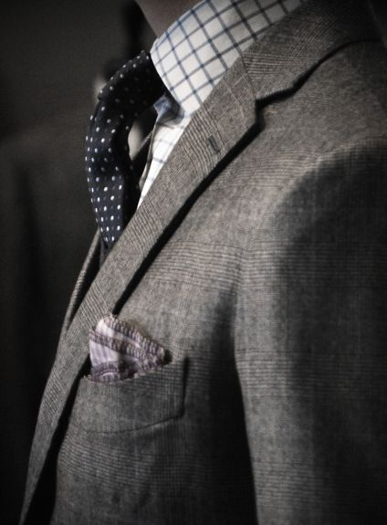 Prince of Wales check suit with navy tie with white polka dots and white shirt with navy check - simple colour palette to max effect