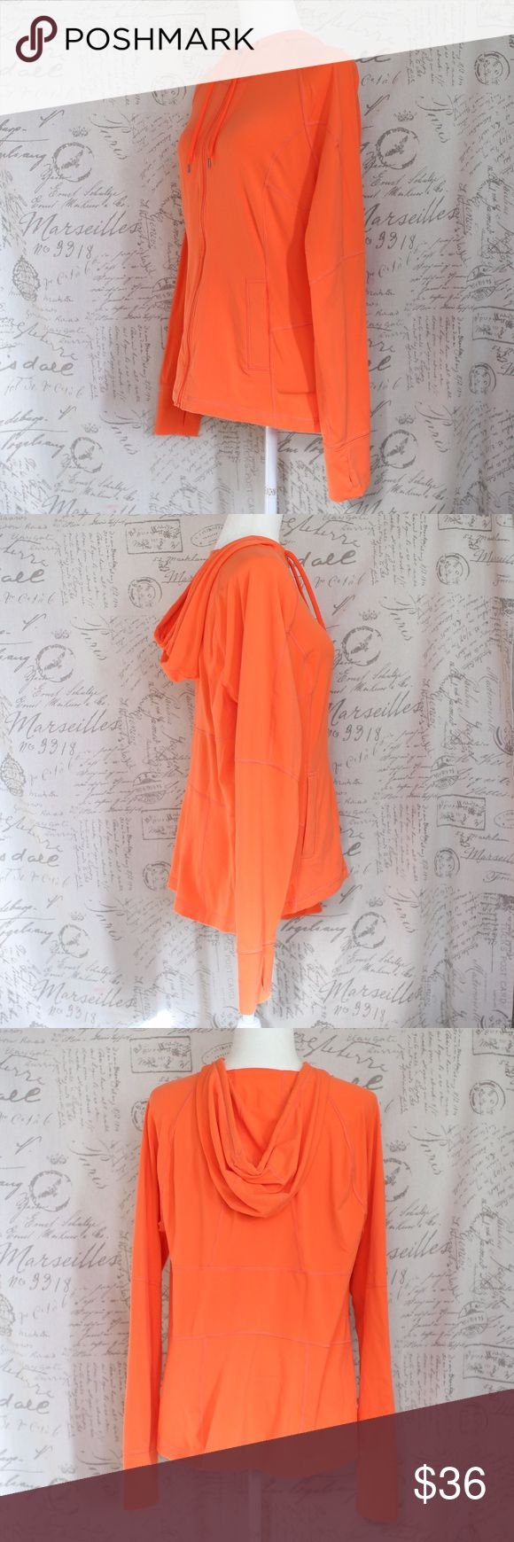 """Lucy Athletic  Orange Stretchy Zip Jacket XL Lucy Athletic  Orange  Stretchy fabric  Two pockets Thumbhole Sleeves Drawstring Hood Extra Large  Measurements taken with garment flat on table. Armpit to armpit: 20"""" Sleeves: 31"""" measured from collar hem Length: 25"""" Lucy Jackets & Coats"""