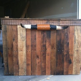 Western headboard made of pallets
