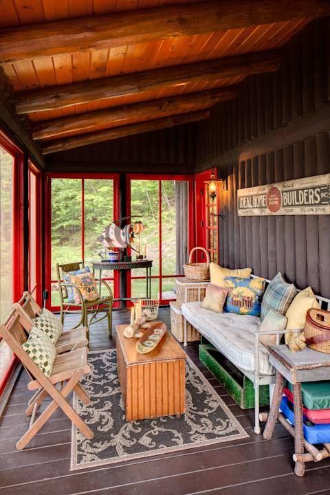 Enclosed 3-season sun porch on a rustic cabin home