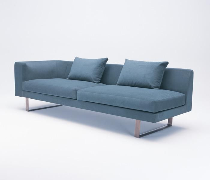 801 | UCI Lounge seating.  Designed by Charles Wilson. Arm chair, 2.5 seater, 3 seater, chaise, corner lounge, and coffee table, all available with an aluminium or timber base. Optional luxurious feather seat cushion. GECA certified. uci.com.au