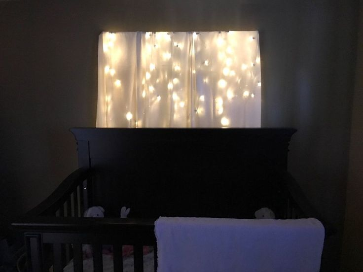Woman drapes Christmas lights over a curtain rod—look at her awesome idea for your bedroom!