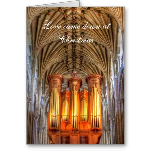 """The words: """"Love came down at Christmas"""" over a view of the almost glowing pipe organ in Norwich Cathedral, and its beautiful vaulted ceiling."""