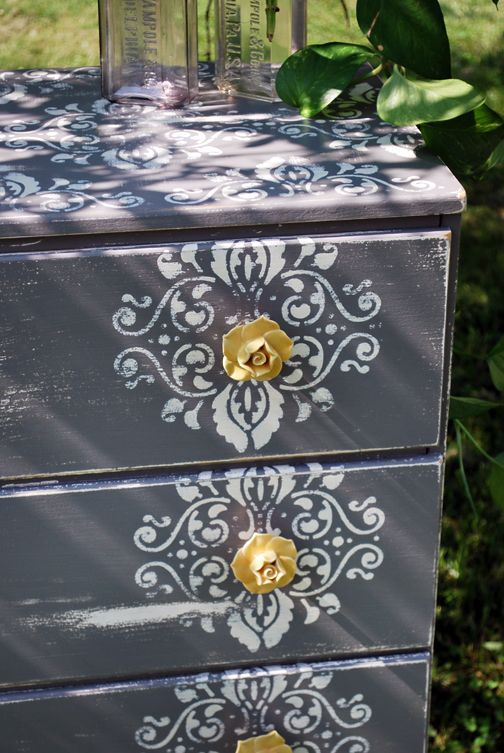 By using a stencil and decorative handles you can transform an old shabby dresser.