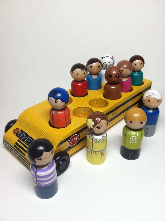 wooden bus and eleven hand-painted wooden peg dolls.