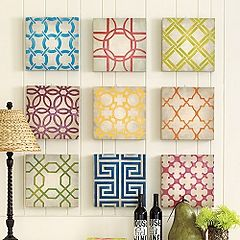 love the  different patterns and colors. a good way to add pops of color to a white wall.
